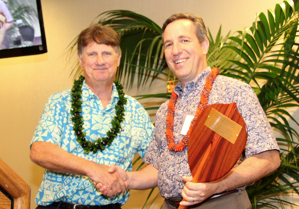 CFS President & CEO Howard Garval (left) presents a special koa paddle to outgoing Board of Directors Chair, Richard Wacker.