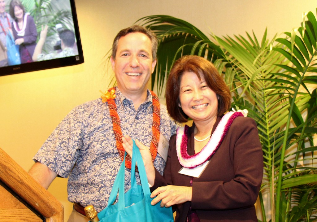 "Outgoing CFS Board of Directors Chair Richard Wacker ""passes the torch"" to incoming CFS Board of Directors Chair, Michele Saito."
