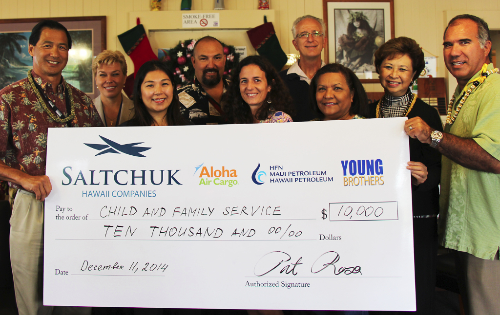 Saltchuk Donation Supports Kaua'i Teen Services : (L-R) Glenn Hong, President,Young Brothers; Natasha Lagmay, Regulatory Financial Analyst, Young Brothers; Novelyn Hinazumi, Director of Kaua'i Programs, Child & Family Service; Michael Chappelle,  Kauai Port Manager,  Young Brothers; Kim Acierto, Program Supervisor-Teen Programs, Child & Family Service; William Harrington, Program Director-Family Centers and Teen Programs, Child & Family Service; Dory Farias, Hale Ho'omalu-Program Manager,  Child & Family Service; Wanda Kau-Shibata, Community Advisory Board Chair, Young Brothers; and Pat Rosa, Chief Operating Officer, Aloha Air Cargo, present a $10,000 check to CFS to support CFS teen programs throughout Kaua'i.
