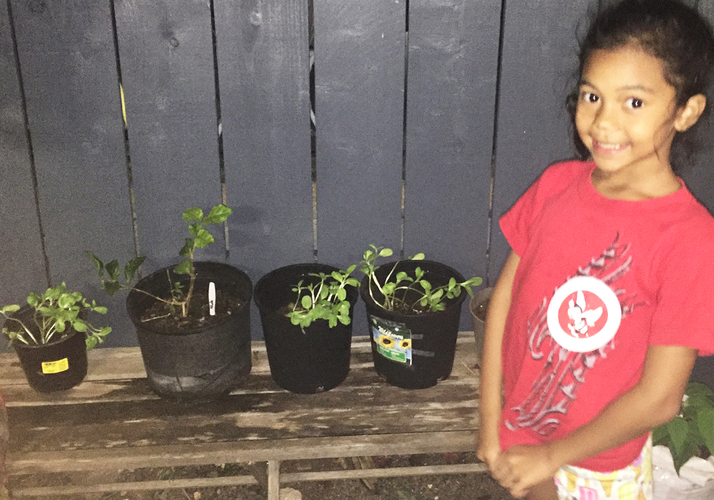 """Tiare"" proudly shows off plants from the garden."