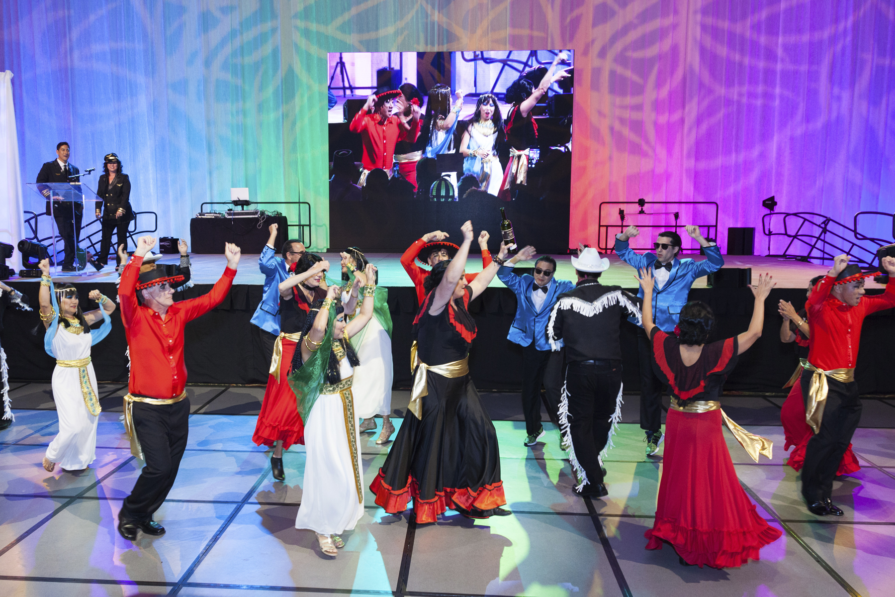 2016 AN EVENING AROUND THE WORLD: A flash mob breaks out on the dance floor while emcees Steve & Liz Uyehara were making an announcement.