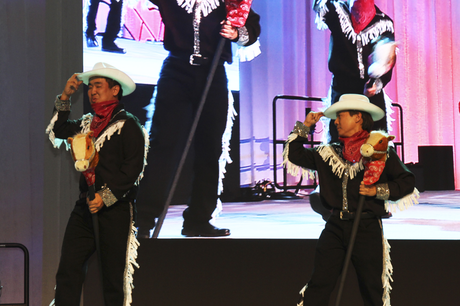 2016 AN EVENING AROUND THE WORLD: Howdy! CFS cowboy performers Michael Young (Albert C. Kobayashi, Inc.) & Glen Kaneshige (Nordic PCL Construction, Inc.) tip their hats to the crowd!