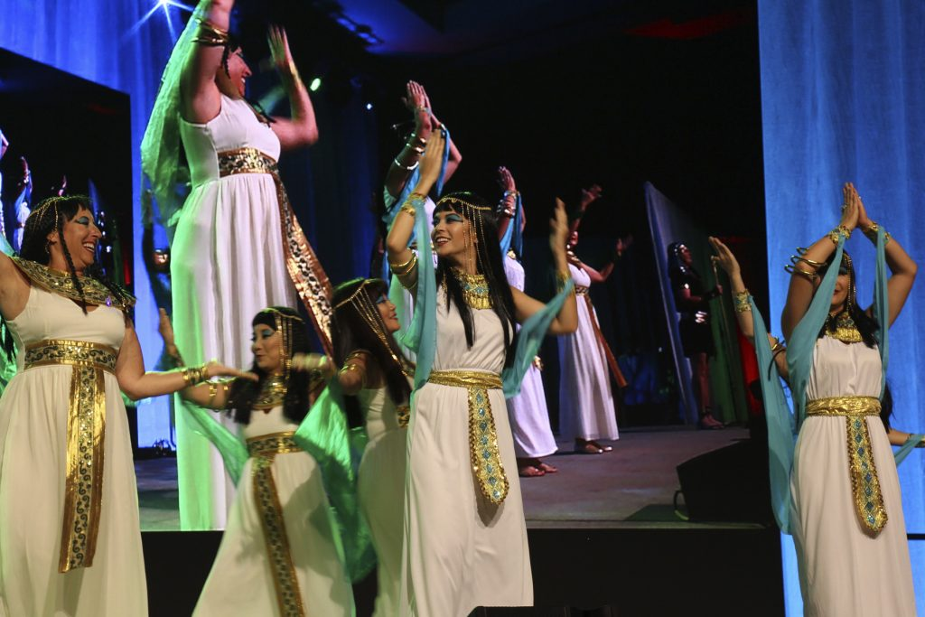 "2016 AN EVENING AROUND THE WORLD: The CFS Egyptian Women Cathy Camp (Kamehameha Schools), Michele Saito (DTRIC Insurance Group), Lisa Rapp (Architects Hawaii Ltd.), Erin Kirihara (Rider Levett Bucknall), & Thuy Nguyen-Martines (Central Pacific Bank) ""walk like an Egyptian"" on stage!"