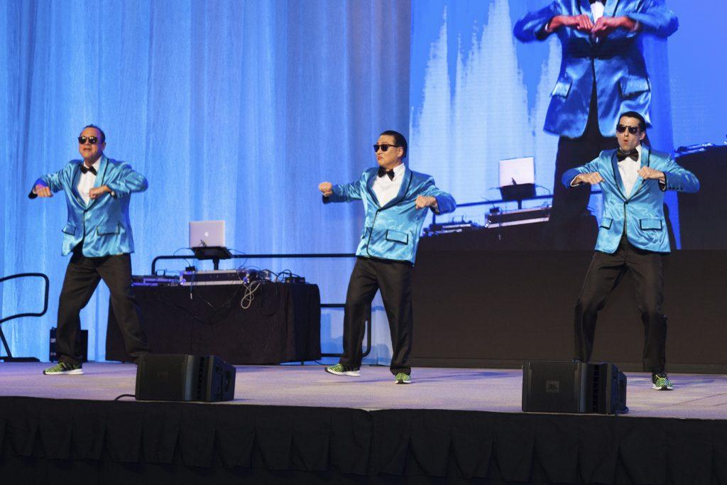 2016 AN EVENING AROUND THE WORLD: The CFS Gangam Style Dancers Anton Krucky (Tissue Genesis, Inc.), Mark Yamakawa (Hawaii Dental Service), & Tony Mizuno (Bank of Hawaii)