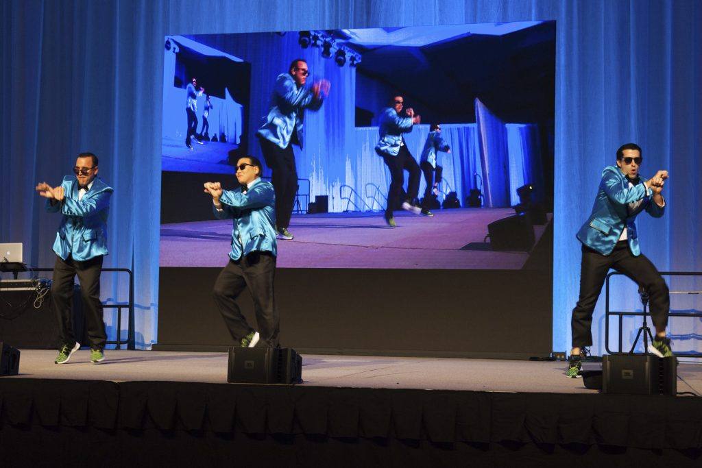 "2016 AN EVENING AROUND THE WORLD: The CFS Gangnam Style Dancers Anton Krucky (Tissue Genesis, Inc.), Mark Yamakawa (Hawaii Dental Service), & Tony Mizuno (Bank of Hawaii) show off their ""PSY"" dance moves!"