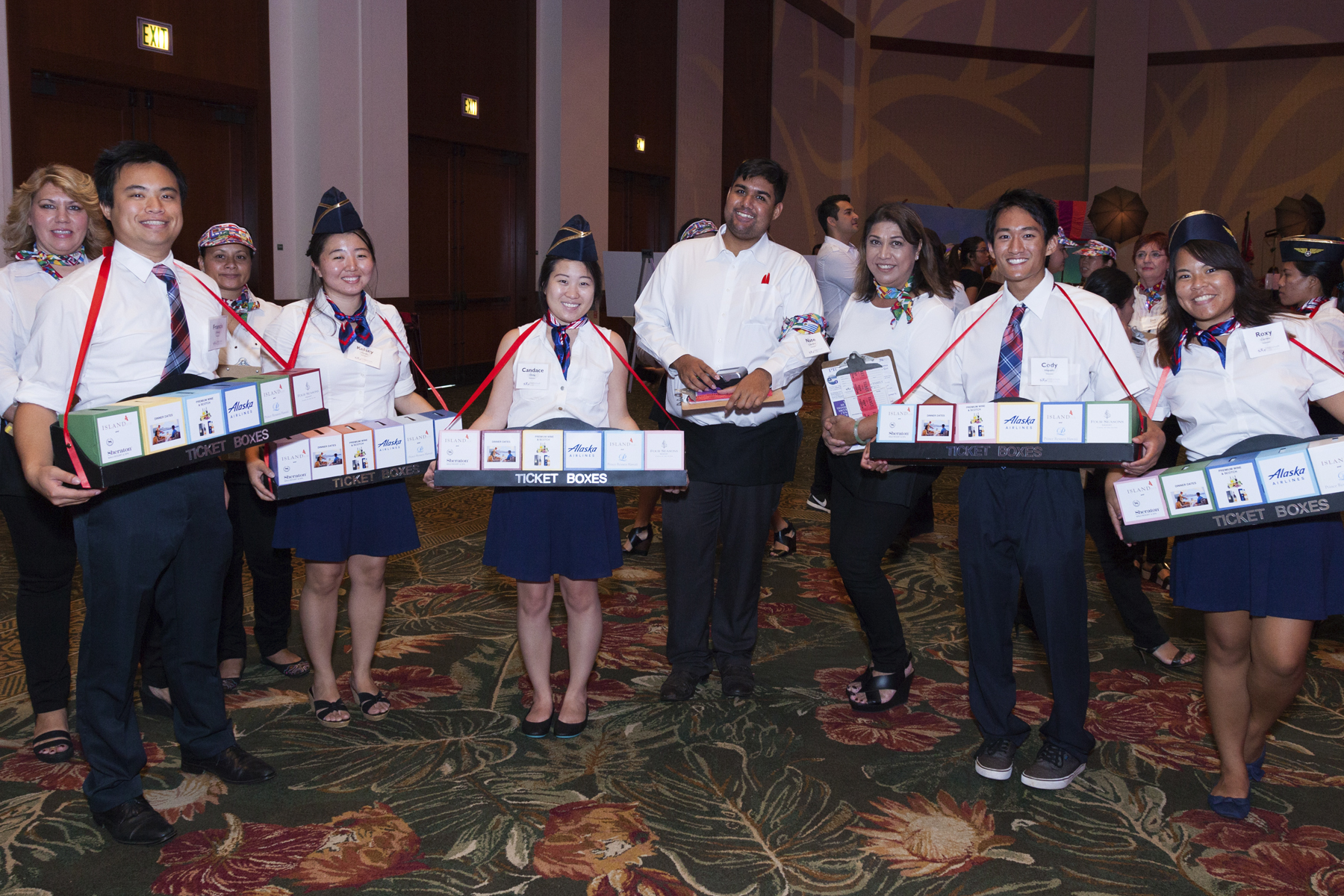 """2016 AN EVENING AROUND THE WORLD: Our great volunteer """"flight attendants"""" roamed the ballroom for guests to make donations."""