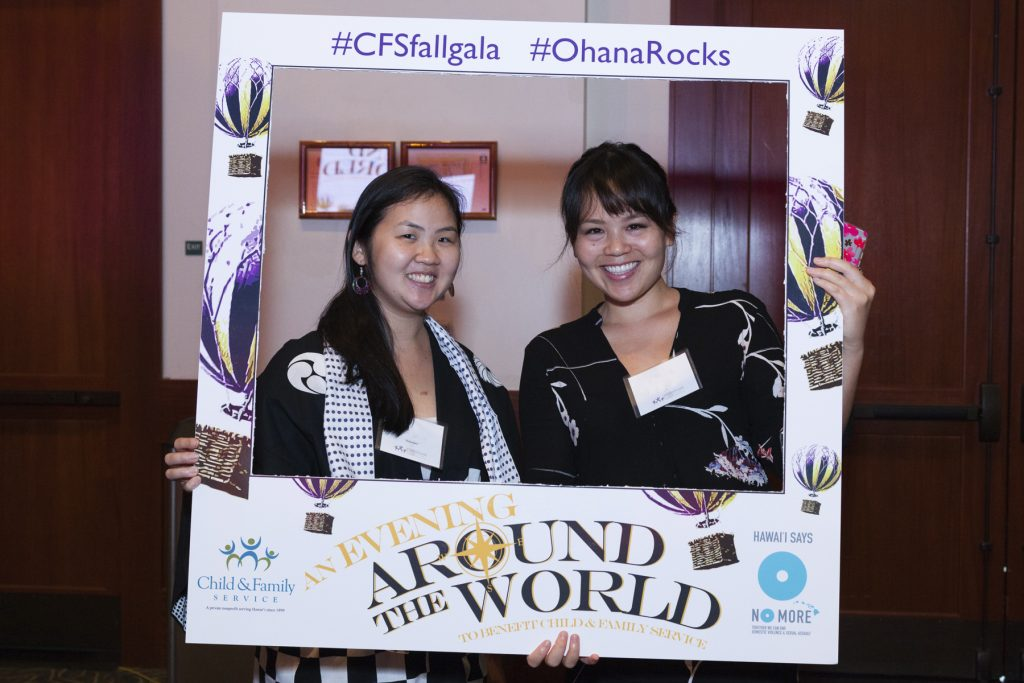2016 AN EVENING AROUND THE WORLD: Our Staff member and volunteer test out our Social Media frame. Check out our Instagram (@CFShawaii) to see the photos from that night!