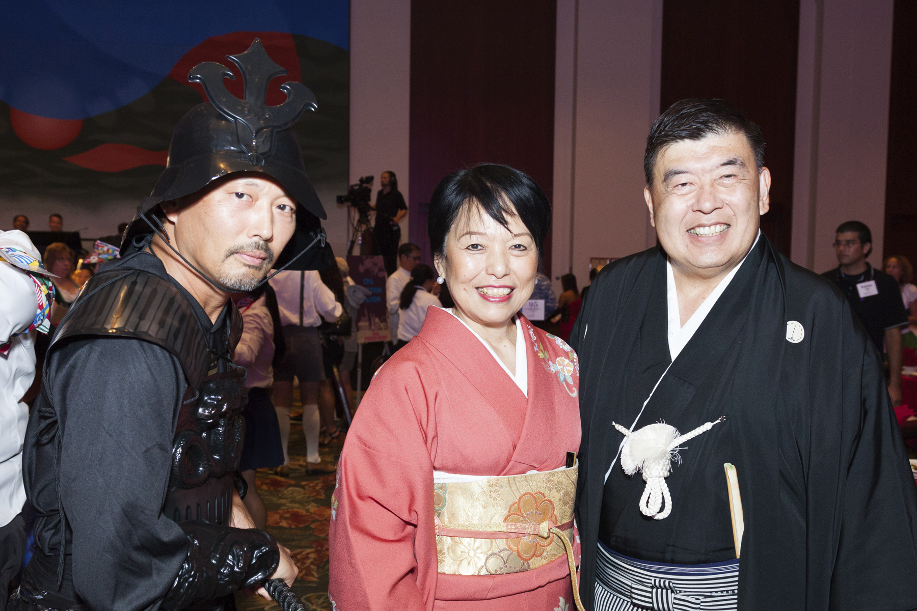 2016 AN EVENING AROUND THE WORLD: Getting into theme with Ruthann & Gregg Yamanaka and their samurai escort!