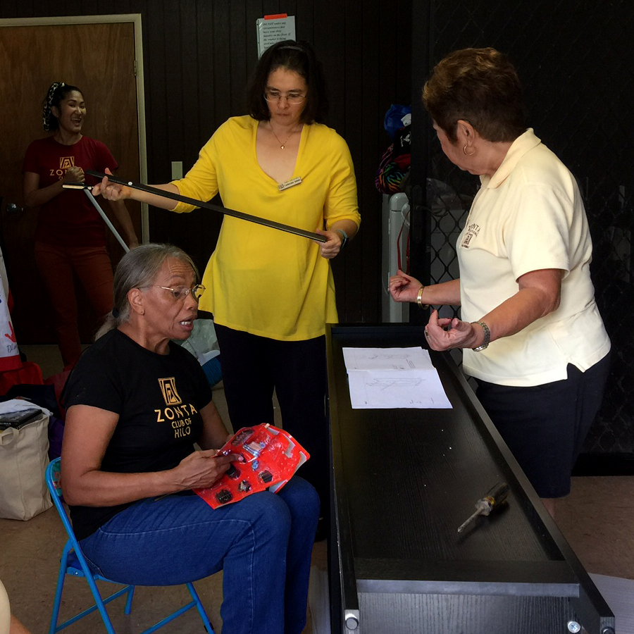The Zonta Club of Hilo members assemble a shelf for the shelter.
