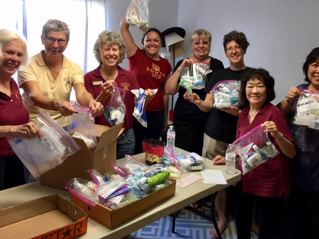 The Zonta Club of Hilo members make packages full of hygine items!